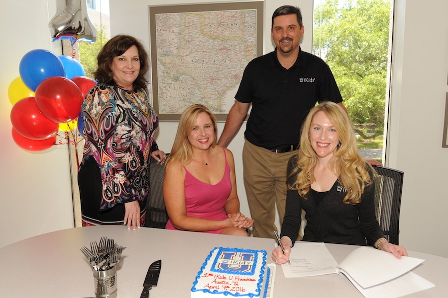 1st IKids U Franchise Owners Signing Documents And Celebrating